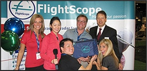 Photo of the Golf Pro Girls winning a FlightScope Kudu at the 2010 PGA Merchandise Show.
