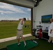 Photo of the Colorado Golf Academy which uses a FlightScope launch monitor at its driving range.