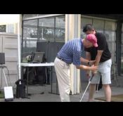 PGA professional Rick Nielsen using a FlightScope golf launch monitor to help with swing adjustments.