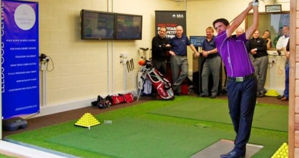 Photo of European Tour star John Parry using a FlightScope golf simulator to track his golf swings.