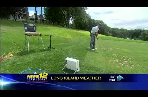 Teacher of the Year Joseph Laurentino demonstrates the FlightScope X2 launch monitor's electronic golf ball tracking capabilities.