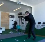 Photo of Steven McDaniel using a FlightScope golf launch monitor for practice sessions.
