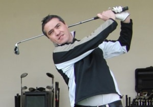 Photo of Steve Wilson trying out a FlightScope launch monitor's electronic golf ball tracking capabilities.