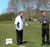 Michael Jacobs and Rick Nielsen discussing how a FlightScope launch monitor can be used to make swing adjustments.