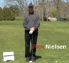 Photo of Rick Nielsen using a FlightScope golf launch monitor / golf ball tracker to help teach wedge play.
