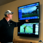 Dennis McDonald pointing to data from a FlightScope golf launch monitor / golf ball tracker.