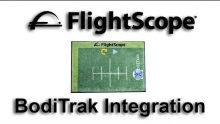 Photo promoting the FlightScope launch monitor and BodiTrak pressure mat sensor integration feature.