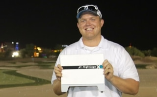 Photo of Eric Matthewson who won a new FlightScope Xi launch monitor / golf ball tracker after winning the World Golf Skills Challenge.