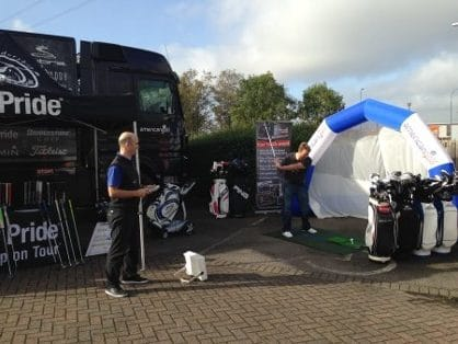 Photo of American Golf Tour Trucks using FlightScope launch monitors for club fitting and golf lessons.