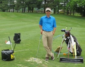 Photo of Michael Wheeler who is using a FlightScope launch monitor / golf ball tracker to test a golf myth.