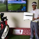Photo of golfer Junji Takada holding a FlightScope Xi+ launch monitor / golf ball tracker.