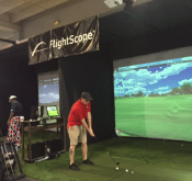 Photo showing a veteran using the Flightscope's virtual golf simulator at the Fairways for Warriors Training and Life Center.