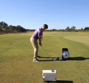 Chris Tyler demonstrates how to use Flightscope launch monitors to prevent early extension in golf swings.